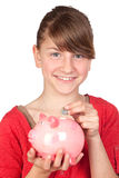Funny girl with pink piggy-bank Stock Photos