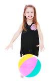 Funny girl playing ball Stock Image