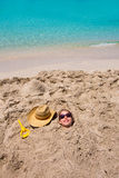 Funny girl playing buried in beach sand smiling sunglasses Stock Photos