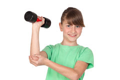 Funny girl playing sports with weights Royalty Free Stock Photos