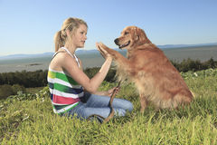 Funny girl plays with the dog outside Stock Image