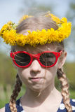 Funny girl portrait in dandelion garland Royalty Free Stock Photography