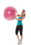 Funny girl posing in sportswear with pink ball Royalty Free Stock Photo
