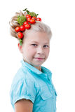 Funny girl posing with wreath of tomatoes Stock Photos