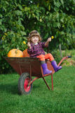 Funny girl with pumpkins in the garden Stock Photos