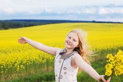 funny girl on rape field Royalty Free Stock Photos