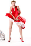 Funny girl in red gala dress Royalty Free Stock Photography