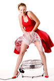 Funny girl in red gala dress that blows up Royalty Free Stock Photos