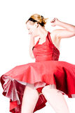 Funny girl in red gala dress dancing Stock Images