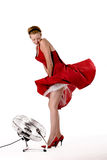 Funny girl in red gala dress playing Stock Image