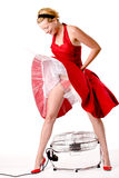 Funny girl in red gala dress standing Stock Photo