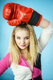 Funny girl in red gloves playing sports boxing Stock Photo