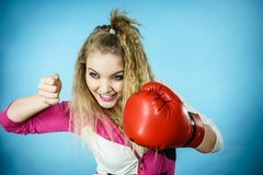 Funny girl in red gloves playing sports boxing stock images