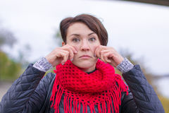 Funny girl in red scarf oudoor. In autumn day Stock Photos