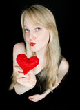 Funny girl with red valentine's heart Stock Image