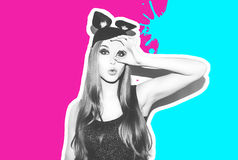 Funny girl represents a small cat or mouse. Woman with a bright makeup hairstyle and night dress mouse ears having fun Royalty Free Stock Photography