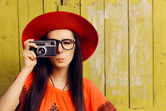 Funny Girl with Retro Photo Camera and Red Sun Hat Royalty Free Stock Photography