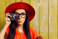 Funny Girl with Retro Photo Camera and Red Sun Hat Royalty Free Stock Photo