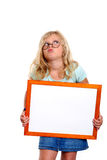 Funny girl with round glasses showing white sign Royalty Free Stock Images