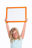 Funny girl with round glasses showing white sign Royalty Free Stock Photography