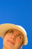 Funny girl's face. Isolated over blue Stock Photo
