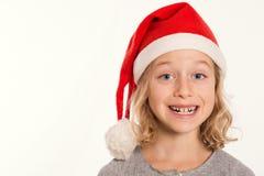 Funny girl with Santa- Claus cap Stock Photo