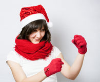Funny girl in santa's hat boxing Royalty Free Stock Photos