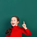 Funny girl and school desk Royalty Free Stock Photo