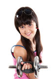 Funny girl in shirt holding dumbbell Royalty Free Stock Photos