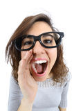 Funny girl shouting and calling with her hand at her mouth Stock Photos