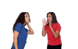 Funny girl shouting somethin to her friend stock photo