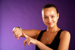 Funny girl shows her finger at the clock. (time Stock Photos