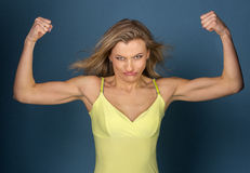 Funny girl shows muscles Stock Image