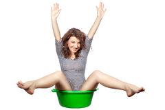 Funny girl sitting in a basin. Royalty Free Stock Images