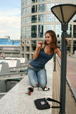 Funny girl sitting on railing Royalty Free Stock Photos