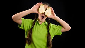 Funny girl with sliced fruits on his eyes, stop motion animation stock footage