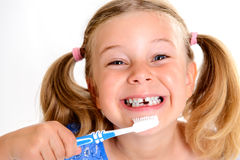 Funny girl with space width and toothbrush Stock Photo