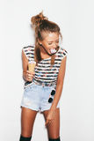 Funny girl spitting out ice cream Royalty Free Stock Photography