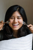 Funny girl with spoon and fork Stock Images