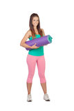 Funny girl in sportswear with a mat Royalty Free Stock Photography