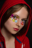 Funny girl with stickers eyes Stock Photo