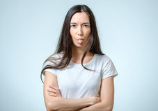 Funny girl sticking her tongue out Stock Image