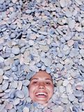 Funny girl in stones Royalty Free Stock Photos
