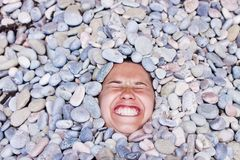 Funny girl in stones Stock Images