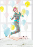 Funny girl in striped pajamas Stock Images
