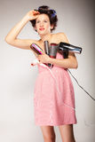 Funny girl styling hair holds many accessories Stock Photo