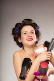 Funny girl styling hair holds many accessories Royalty Free Stock Image