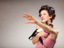 Funny girl styling hair holds many accessories Stock Image