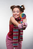 Funny girl with sugarplum Royalty Free Stock Image