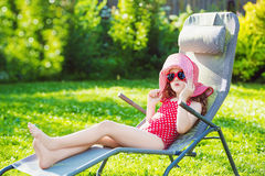 Funny girl sunbathes on a sun lounger. Stock Images